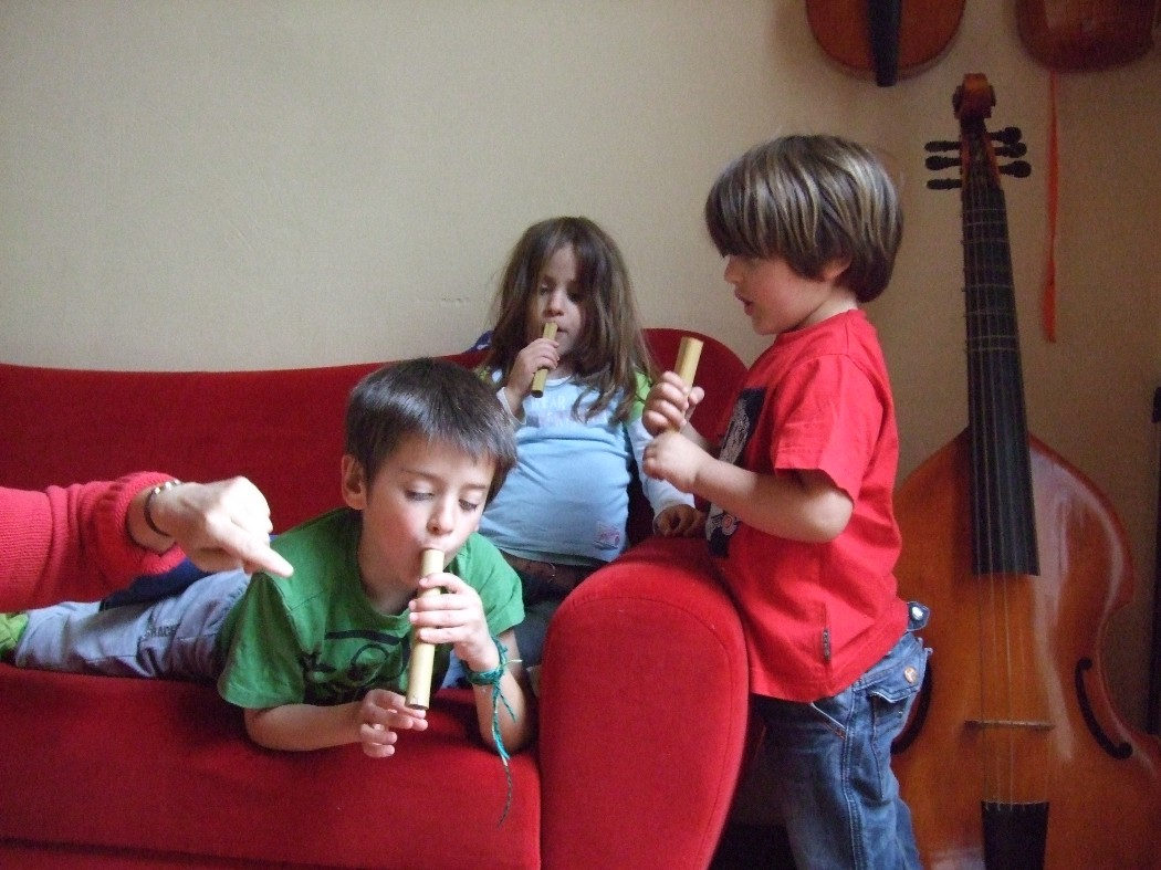 photo, Matteo, Melianna and Mirko on the one tone bamboo flutes